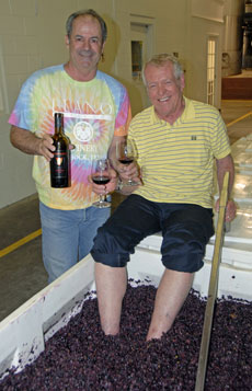 Tumbleweed Smith stomping grapes at Llano Estacado Winery with winemaker Greg Bruni